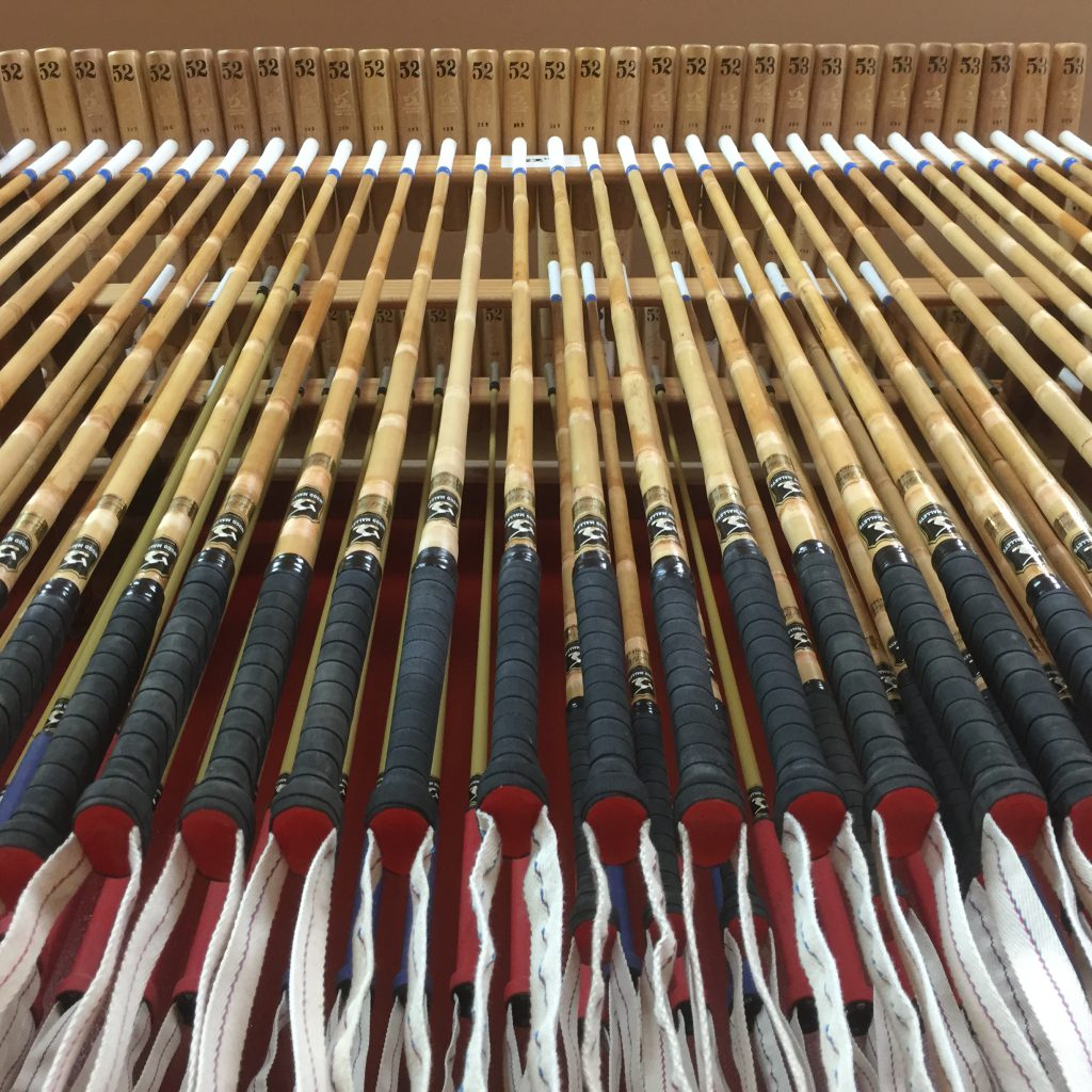 Rack of polo mallets ready for sale